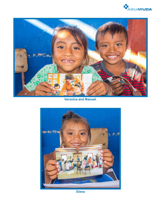 Aguayuda chidren posing with pictures of THFM children
